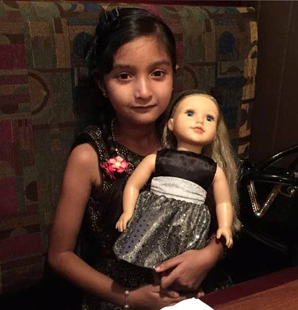 BIG DREAMS: Anisha Rampersad with one of her dolls.