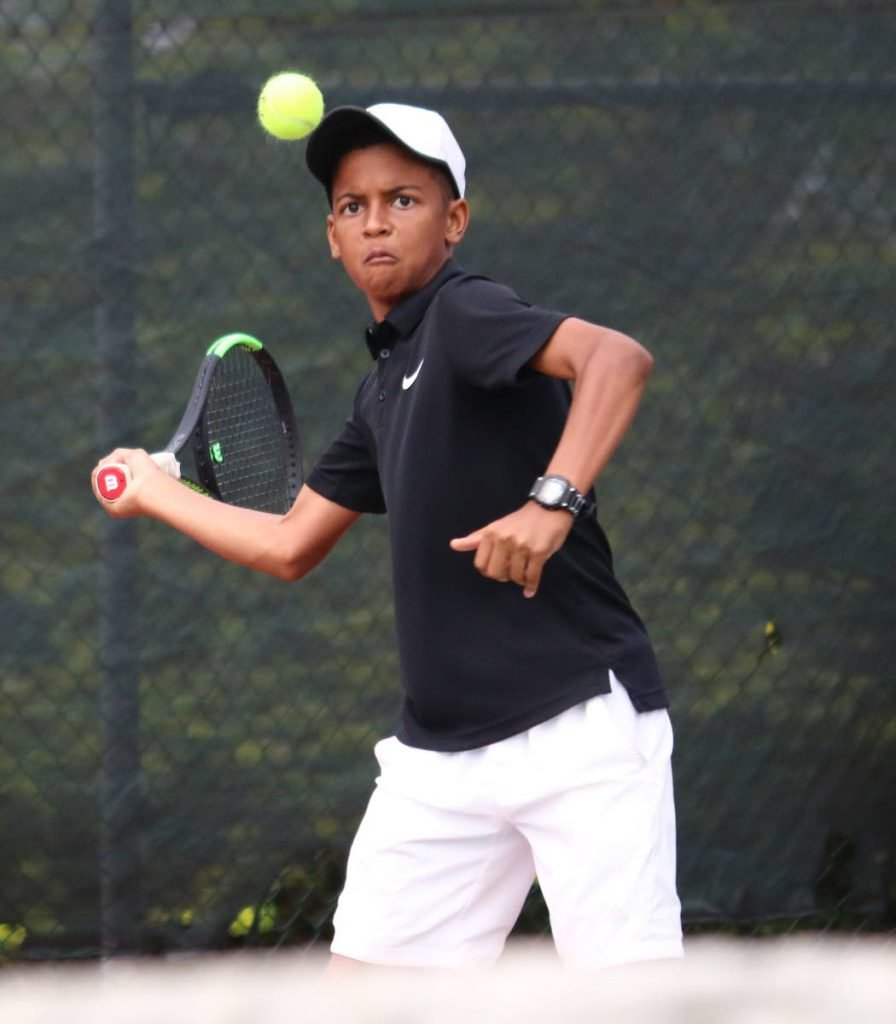 Jamal Alexis on his way to victory in the Boys Under-14 final at the Sagicor Junior Tennis Tournament. PHOTO BY XAVIER SYLVESTER