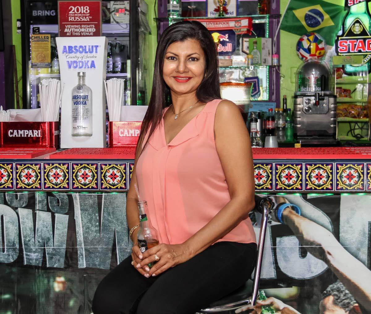 Lisa McKenzie sits in the pub co-founded by her husband, Ricardo 'Smokey' McKenzie. Photo by Jeff K Mayers
