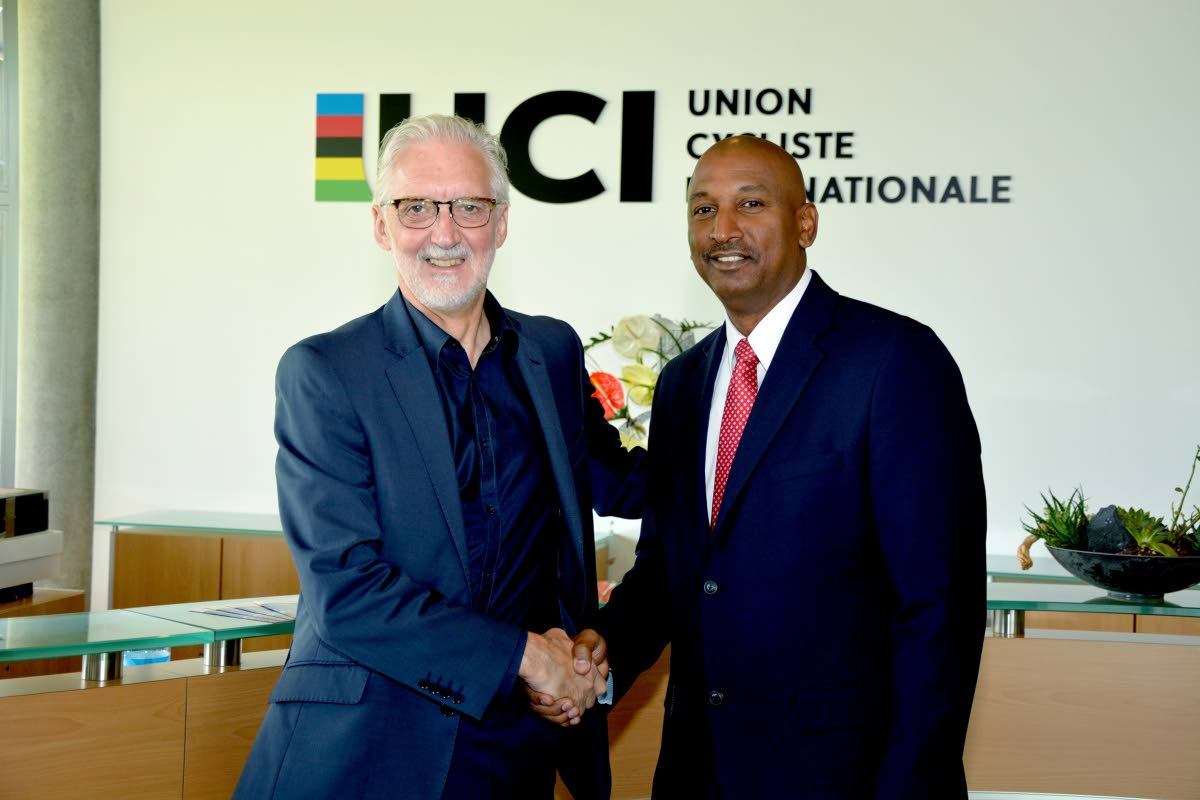 TT cycling boss Robert Farrier, right, shakes the hand of former International Cycling Union (UCI) president Brian Cookson.