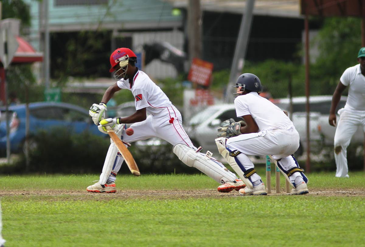 Trinidad and Tobago batsman,Anderson Miles plays a stroke  during the Cricket West Indies regional under 17 tournament held at Gilbert park, Couva, yesterday.