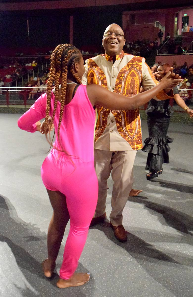 Chief Secretary Kelvin Charles dances with a performer with the Tobago THETA Company at the close of festivities of the opening ceremony of the Tobago Heritage Festival on Friday night at Shaw Park Cultural Complex. Photo by Vidya Thurab