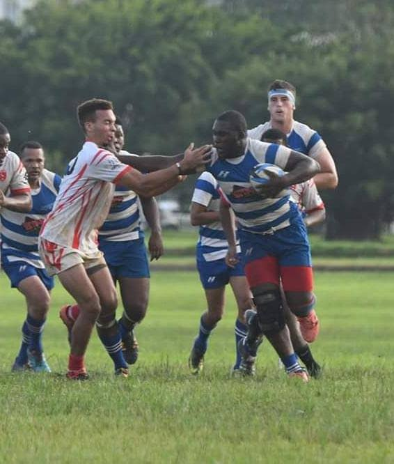 Jessie Richards of Trinidad Northern RFC pushes past a Caribs players during both teams' TTRFU Championship Division fixture, at the Queen's Park Savannah, Port of Spain, Saturday. Northern won the match 10-5.
