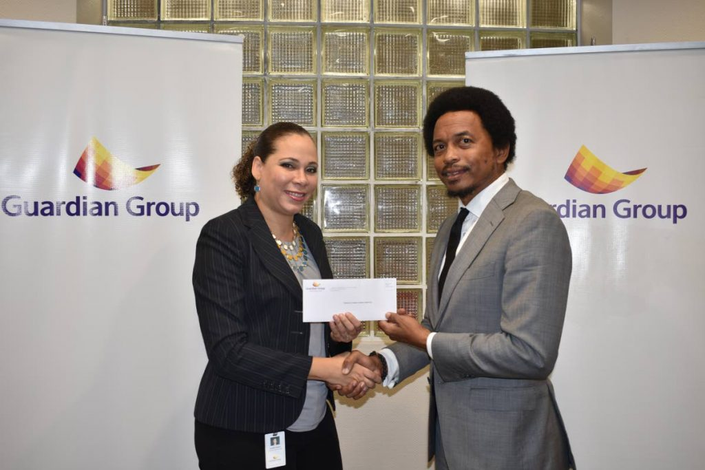 TTOC president Brian Lewis , right, collects a cheque from Ayesha Boucaud-Claxton, Guardian Group's senior manager, group corporate communications, to aid the TTOC's #10golds24 athlete welfare and preparation fund recently.