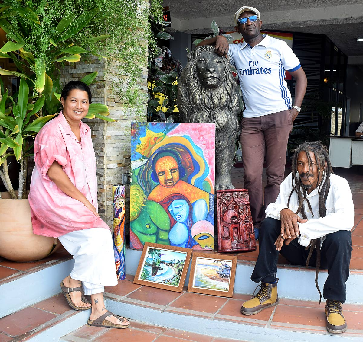 From left, Jeannine Lethe Crouth, Chris Thomas and Joseph Bacchus show of some of the art pieces which would be on show in the exhibit, Melee and Mythos in Tobago Lore, at the Shaw Park Cultural Complex from July 22. Photo by Vidya Thurab