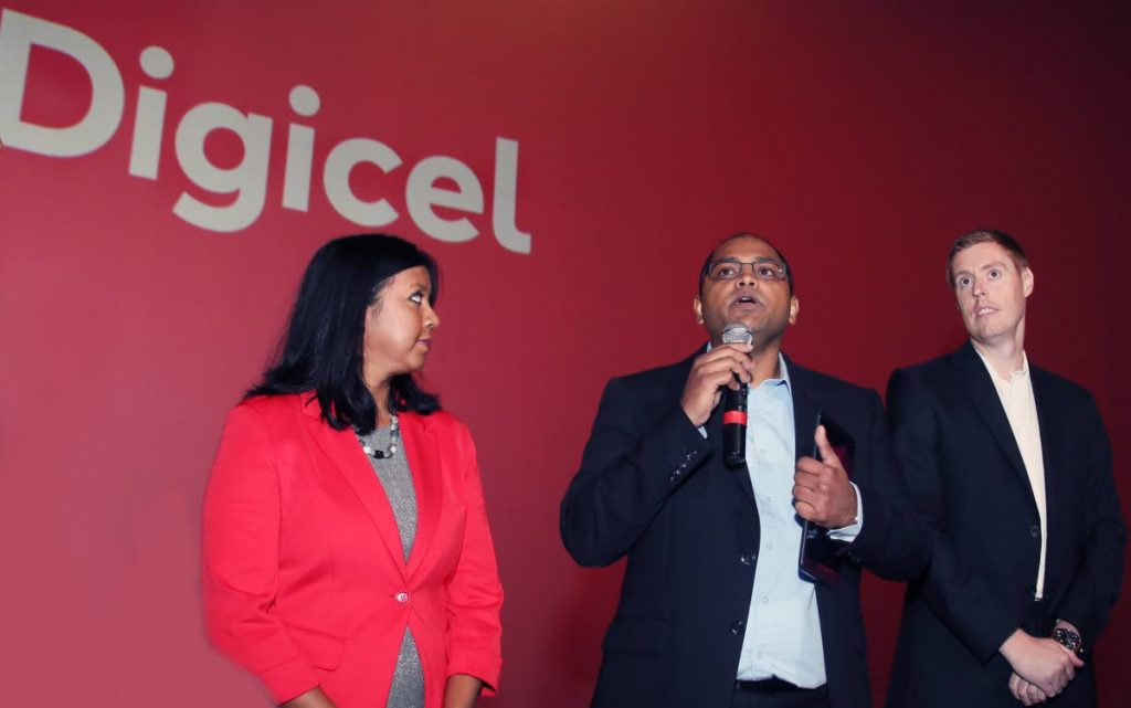 LTE LAUNCH: Digicel's Technical Director Chandrika Samaroo answers questions during the launch of the company's LTE network at Digicel Imax in One Woodbrook Place. Also in photo are Director (Legal)  Desha Cliffor and Chief Financial Officer Trevor North, right.