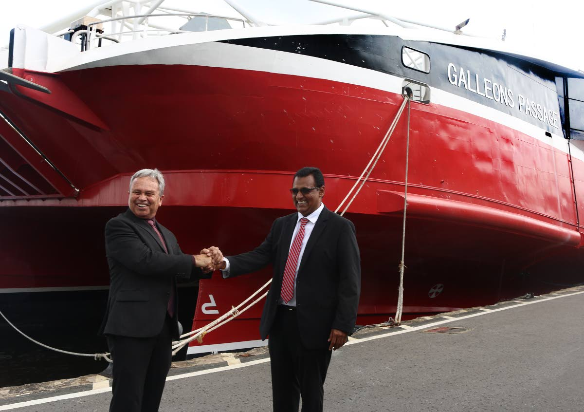 July 17, 2018. Minister of Finance, Colm Imbert shakes hands with Minister of Works and Transport Rohan Sinanan, in front of the Galleons Passage vessel at the Port of Port of Spain. Photo by Xavier Sylvester