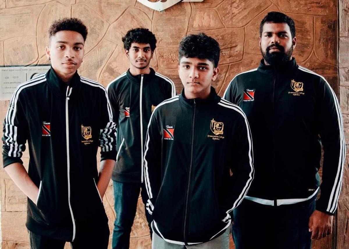 Josef Gonzalez, left, Raydon Baboolal, Avidesh Marajh and Daniel Ramsook (mentor) will represent TT at the international robotics competition in Mexico.