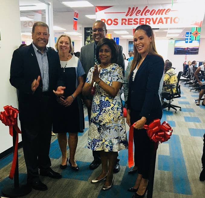 TT's newest business process outsourcing (BPO) office: American Airlines (AA) has opened a new, larger, reservation centre in Maraval. (Left to right) Alfredo Gonzalez, AA's MD for the Caribbean Region; Donna Kostelic, AA's MD of Customer Experience Eastern and International Reservations; Wellesley Joseph, AA's country director; Paula Gopee-Scoon, Trade and Industry Minister; and Rhea Dickie, AA's Reservations Manager at the ribbon cutting ceremony on July 17, 2018. PHOTO COURTESY THE TRADE AND INDUSTRY MINISTRY.