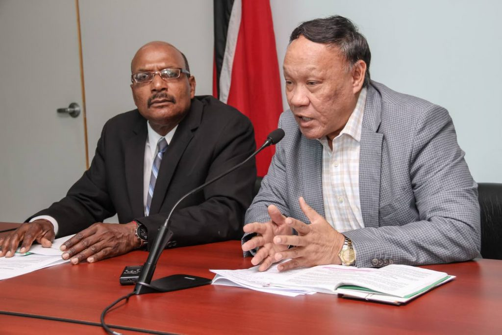 KEEPING IT SHORT: UNC member for Point a Pierre David Lee answering questions during a press conference at the Office of the Leader of the  Opposition, Port of Spain, yesterday. Also in photo is UNC Senator Wade Mark.