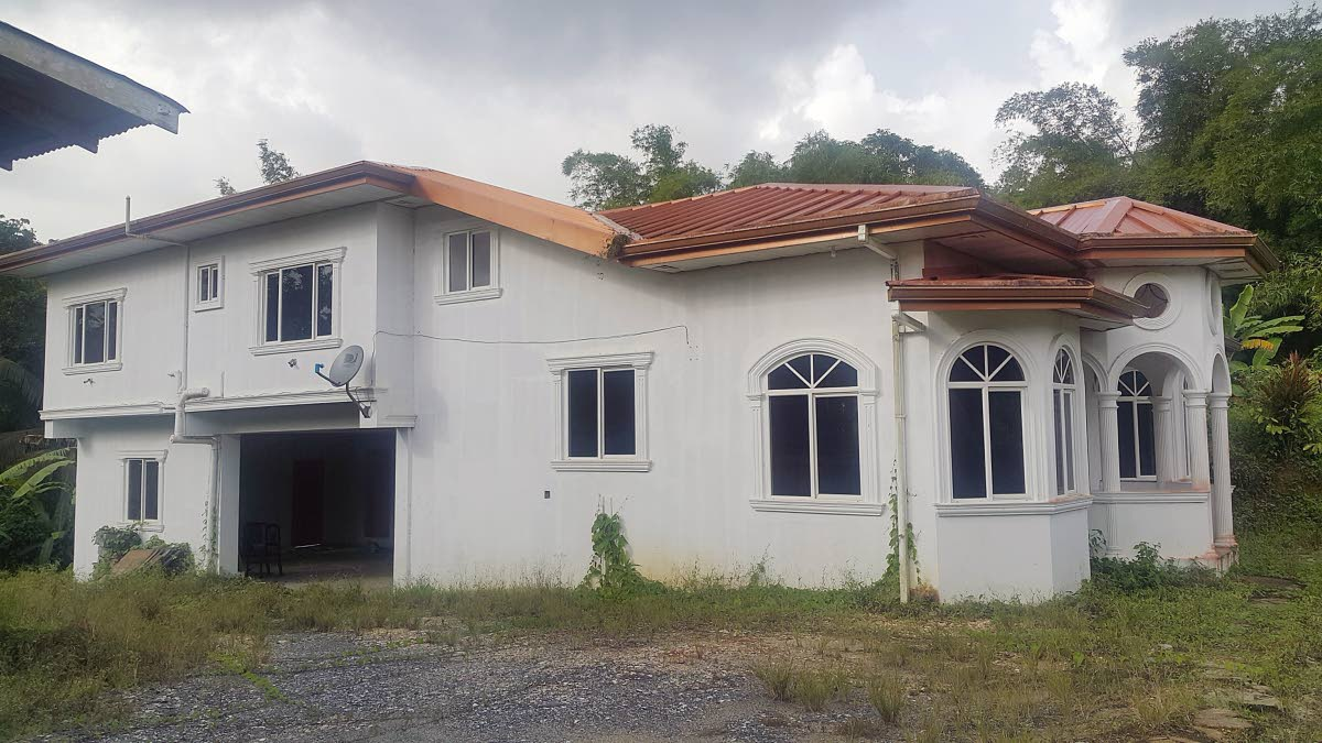 FOR SALE: This house in Sangre Grande was where mother of five Margaret Guevarra was shot dead in February. The house has been put up for sale by the Home Mortgage Bank. PHOTO BY ROGER JACOB