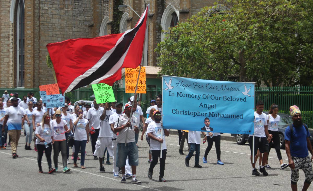 MARCH FOR PEACE: Social pressure group Building TT staged a march for peace yesterday in Port of Spain in memory of murdered Uber driver Christopher Mohammed.