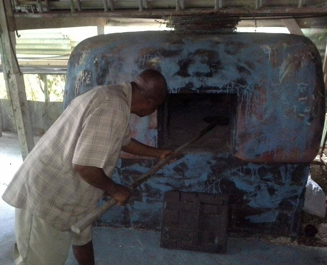 Richard Alfred, co-owner and manager of the Itsy Bitsy Folk Theatre and Museum in Mt Pleasant shows the dirt oven (still in use today) on display.  This oven was built in the 1960s and can hold 25 cakes and sweetbreads at a time.