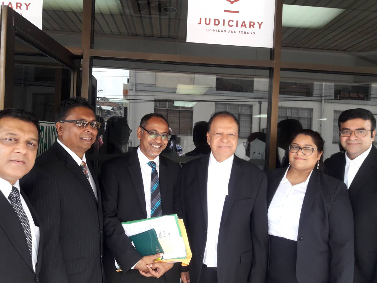 Khemraj Harrikissoon SC (centre) with his fellow attorneys outside San Fernando High Court after he was invited to the inner bar. At right is Harikissoon's daughter Ambika and son Narad, both attorneys