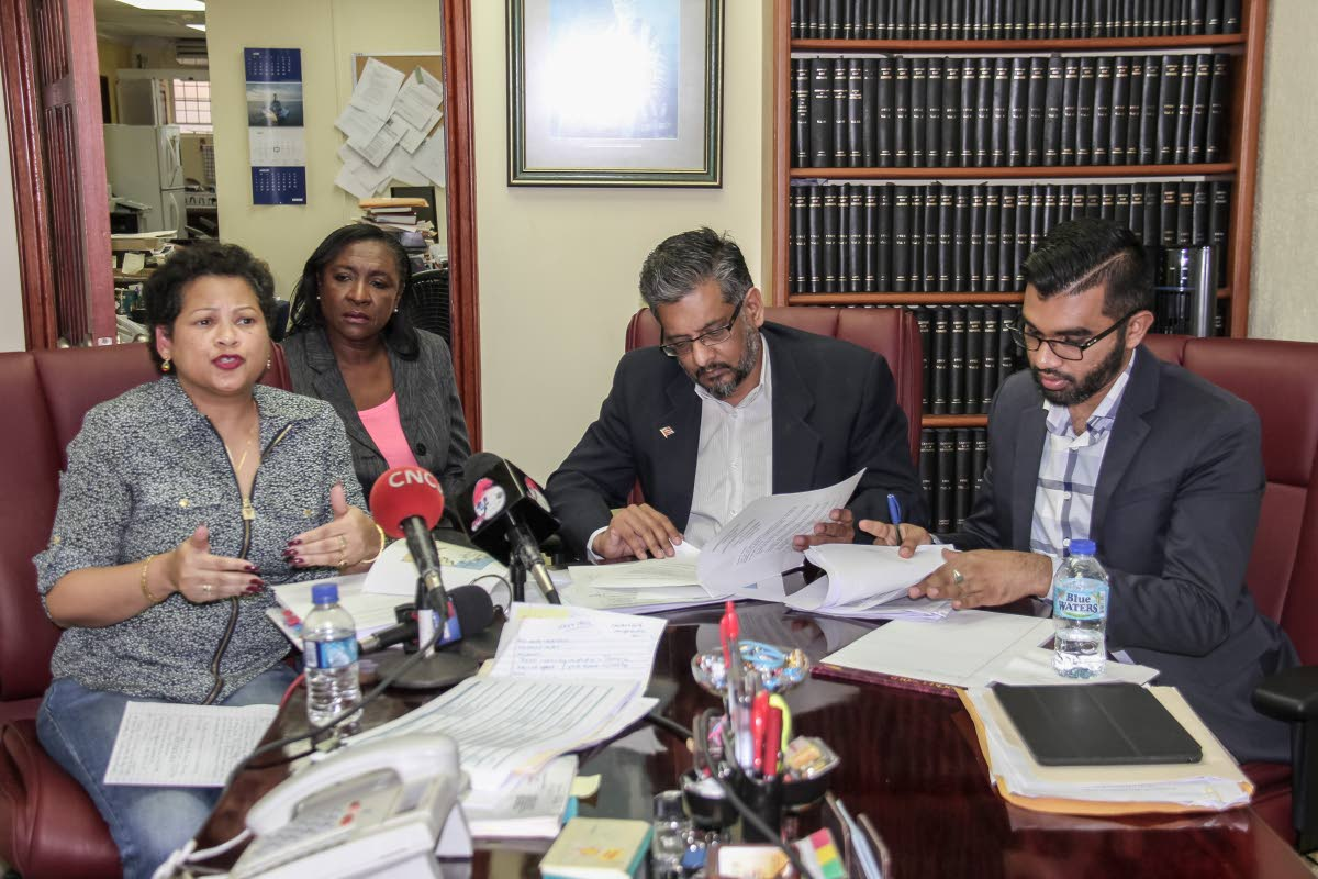 QUESTIONS: Attorney Nyree Alfonso, former Port Authority general manager Charmaine Lewis, former Transport Minister Devant Maharaj and Opposition senator Saddam Hosein at a press conference on the Galleons Passage at Alfonso's St Vincent Street, Port of Spain office on Sunday.