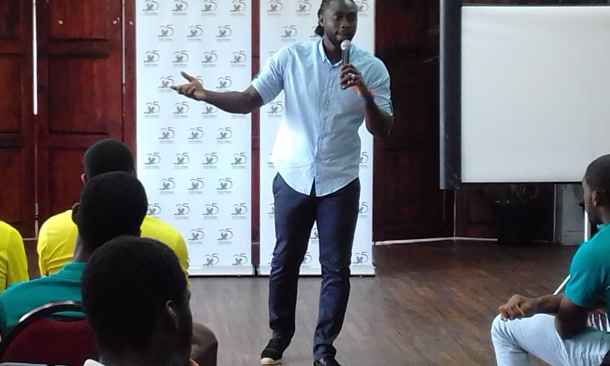 Former TT striker and captain Kenwyne Jones speaking at yesterday's TT Pro League player development seminar.
