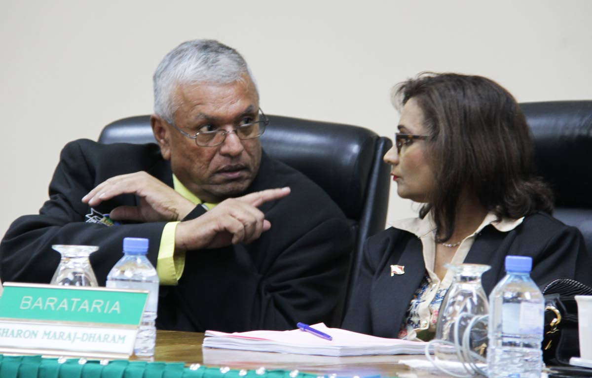 LISTEN: New Barataria councillor Sharon Maraj-Dharam is given a word of advice from San Juan Laventille regional corporation colleague Alderman Nazeemed Mohammed after she was sworn in yesterday.   PHOTO BY ROGER JACOB