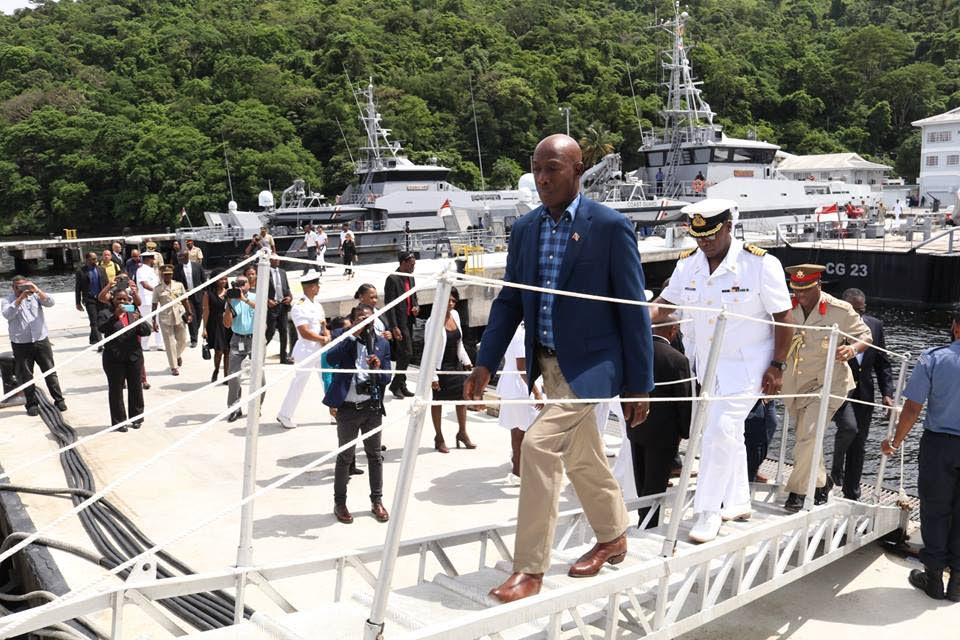 ON DECK: Prime Minister Dr Keith Rowley boards a Coast Guard vessel in Staubles Bay, Chaguaramas yesterday.
