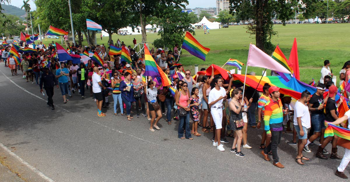 Members of the LGBTQI community and well wishers take part in TT's first gay pride parade throught the streets of Port of Spain yesterday. PHOTO BY ENRIQUE ASSOON
