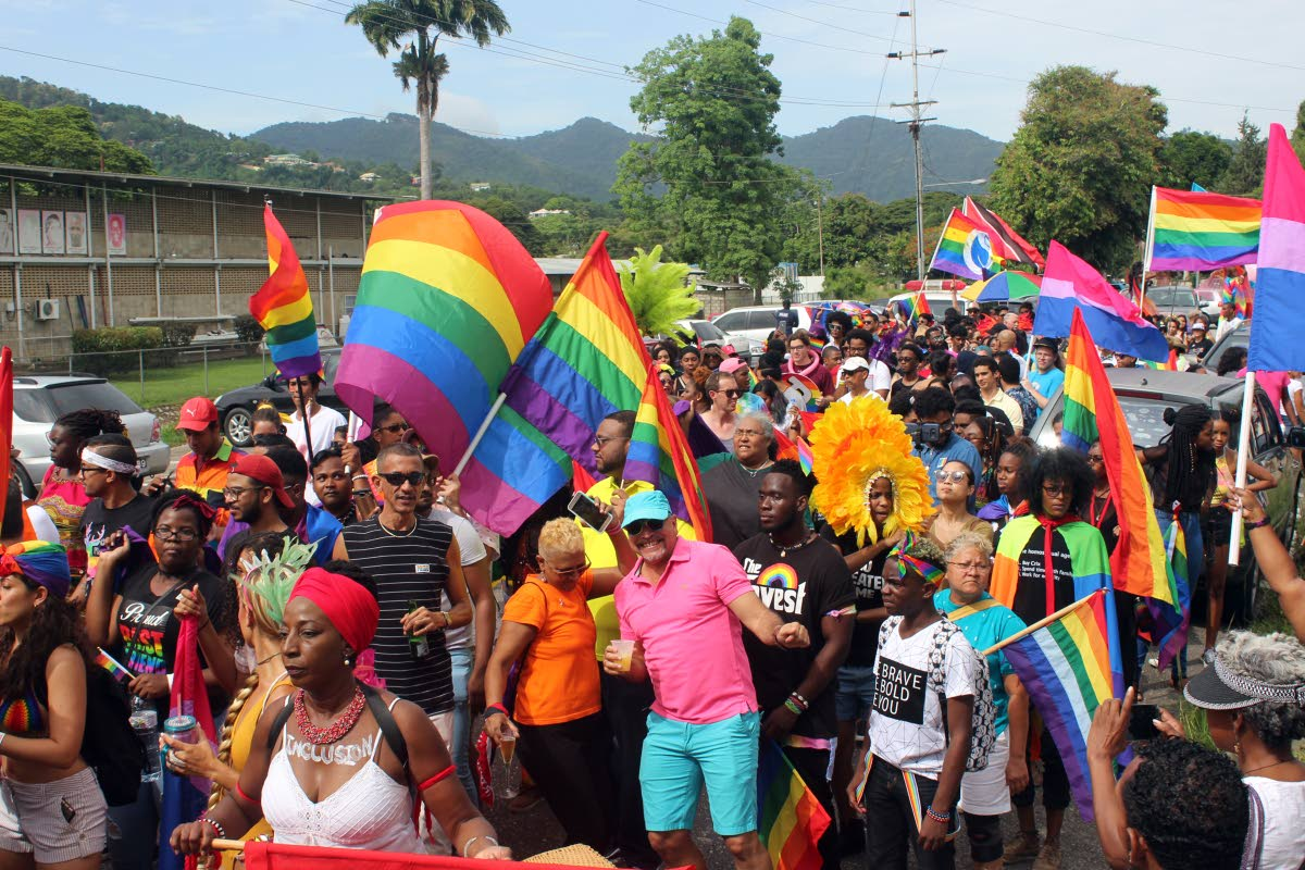 Members of the LGBTQI community and well wishers take part in TT's first gay pride parade throught the streets of Port of Spain in July 2018.