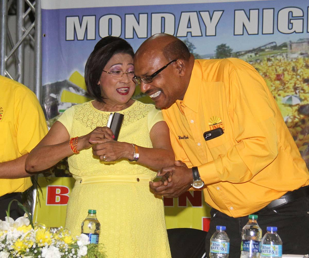 Opposition Leader Kamla Persad-Bissessar and senator Wade Mark.