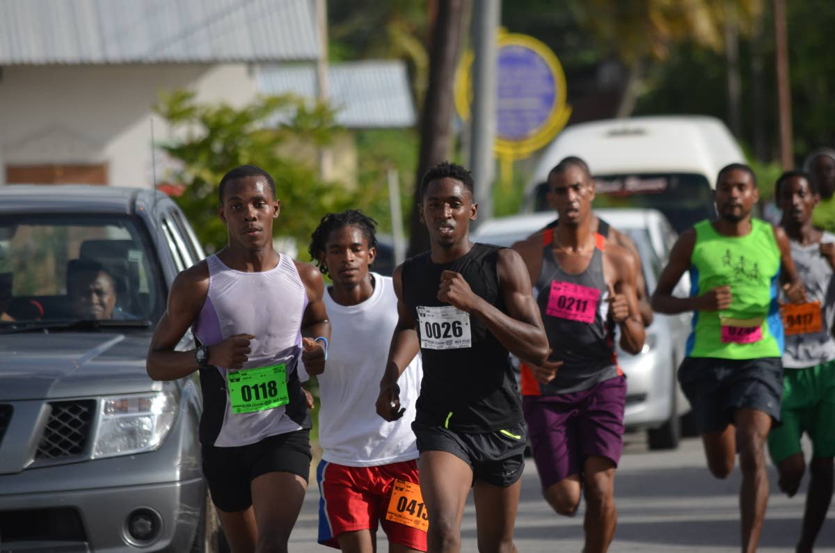 Athletes take off at the start of the 2016 Emancipation Freedom Run in Walke Street, Sangre Grande.
