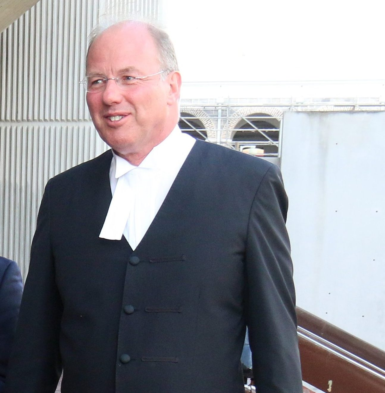 Timothy Starker QC (right) and Anand Ramlogan SC (2nd from right) outside the Hall of Justice after a session in court.  PHOTO:ANGELO M. MARCELLE