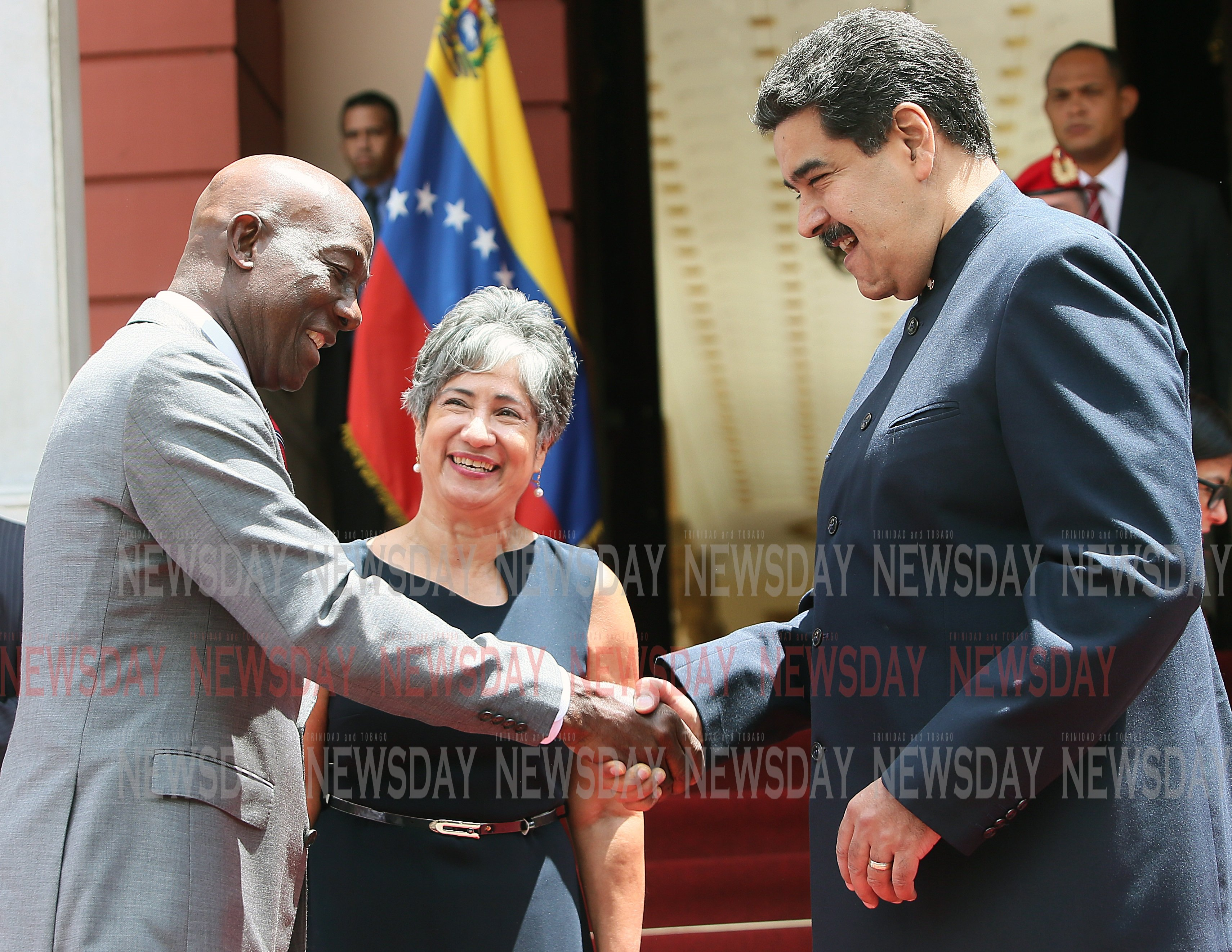 Energy partners: Venezuela's President Nicolas Maduro happily welcomes Prime Minister Dr Keith Rowley to the Miraflores presidential palace in Caracas where the two leaders yesterday sealed a deal for TT to process natural gas in the Dragon field. PHOTO BY AZLAN MOHAMMED