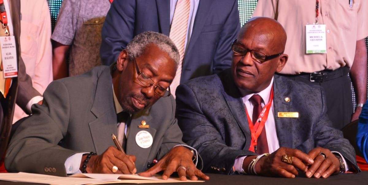 Pan Trinbago secretary Richard Forteau (left) and president Keith Diaz at the signing of a memorandum  of understanding in 2016.