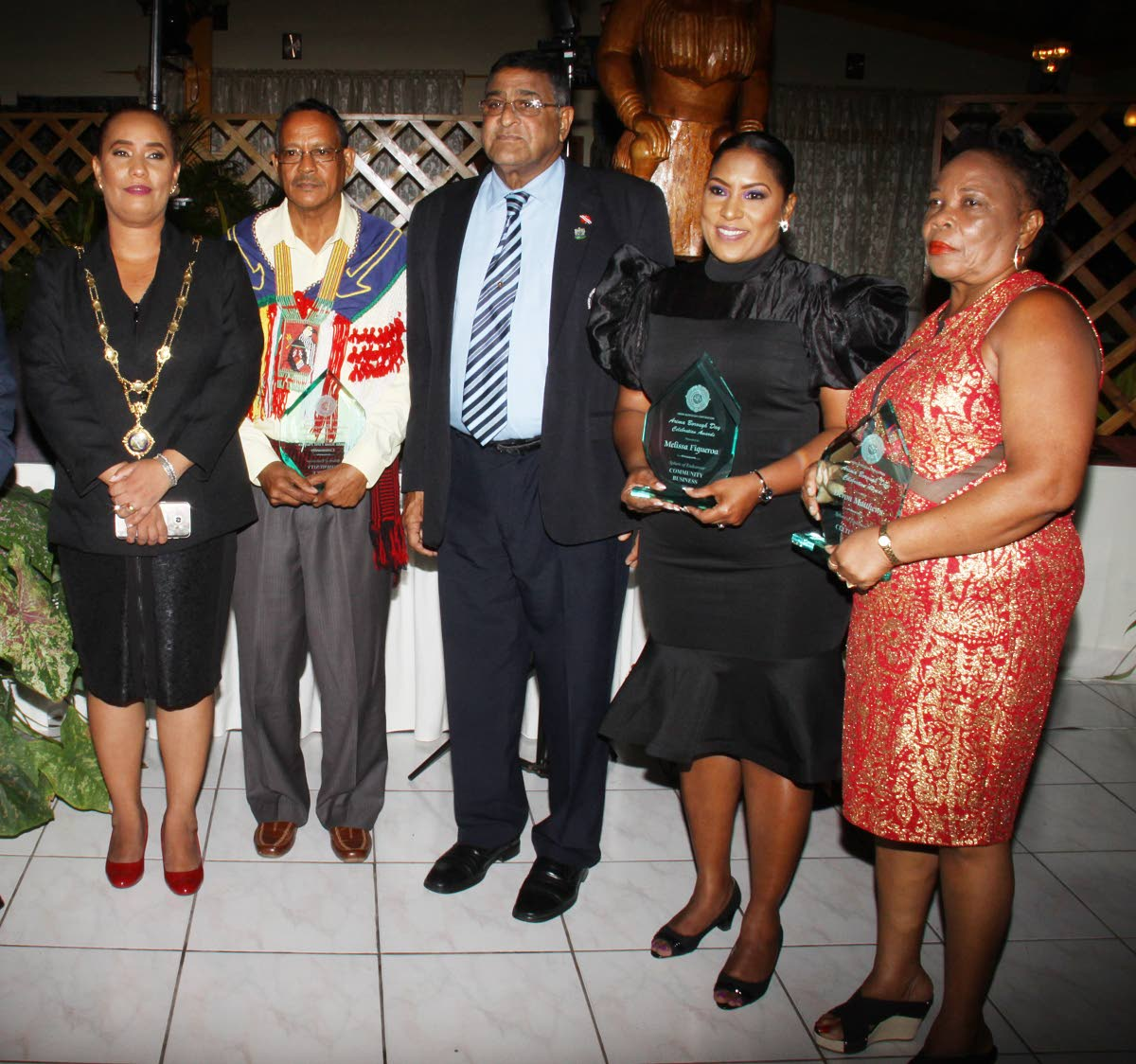 AWARDS TIME: From left, Arima Mayor Lisa Morris-Julien, Carib Chief Ricardo Bharath-Hernandez, Sangre Grande Regional Corporation Chairman Terry Rondon, Melissa Figueroa and Gloria Matthews at the Arima Civic Awards ceremony last week Wednesday.