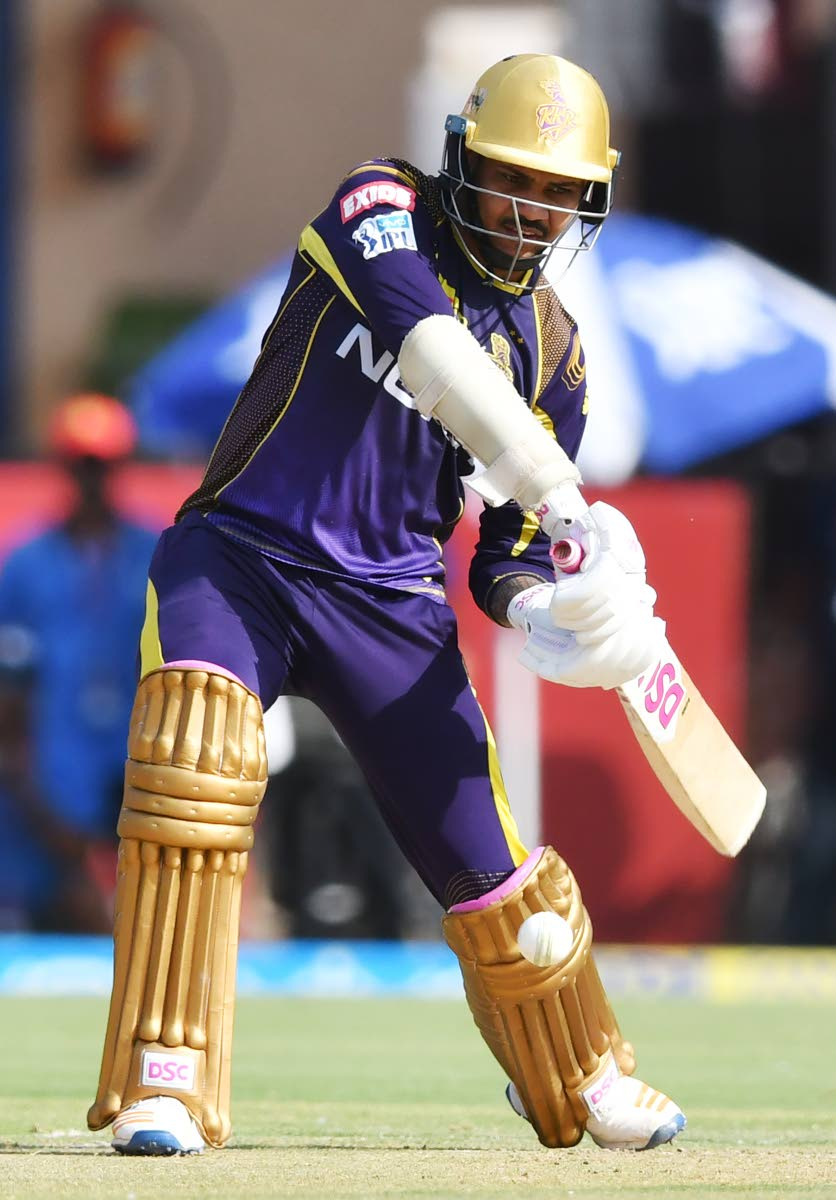 Kolkata Knight Riders cricketer Sunil Narine plays a shot during the 2018 IPL  T20 match between Kings XI Punjab and Kolkata Knight Riders at the Holkar Cricket Stadium in  Indore on May 12.