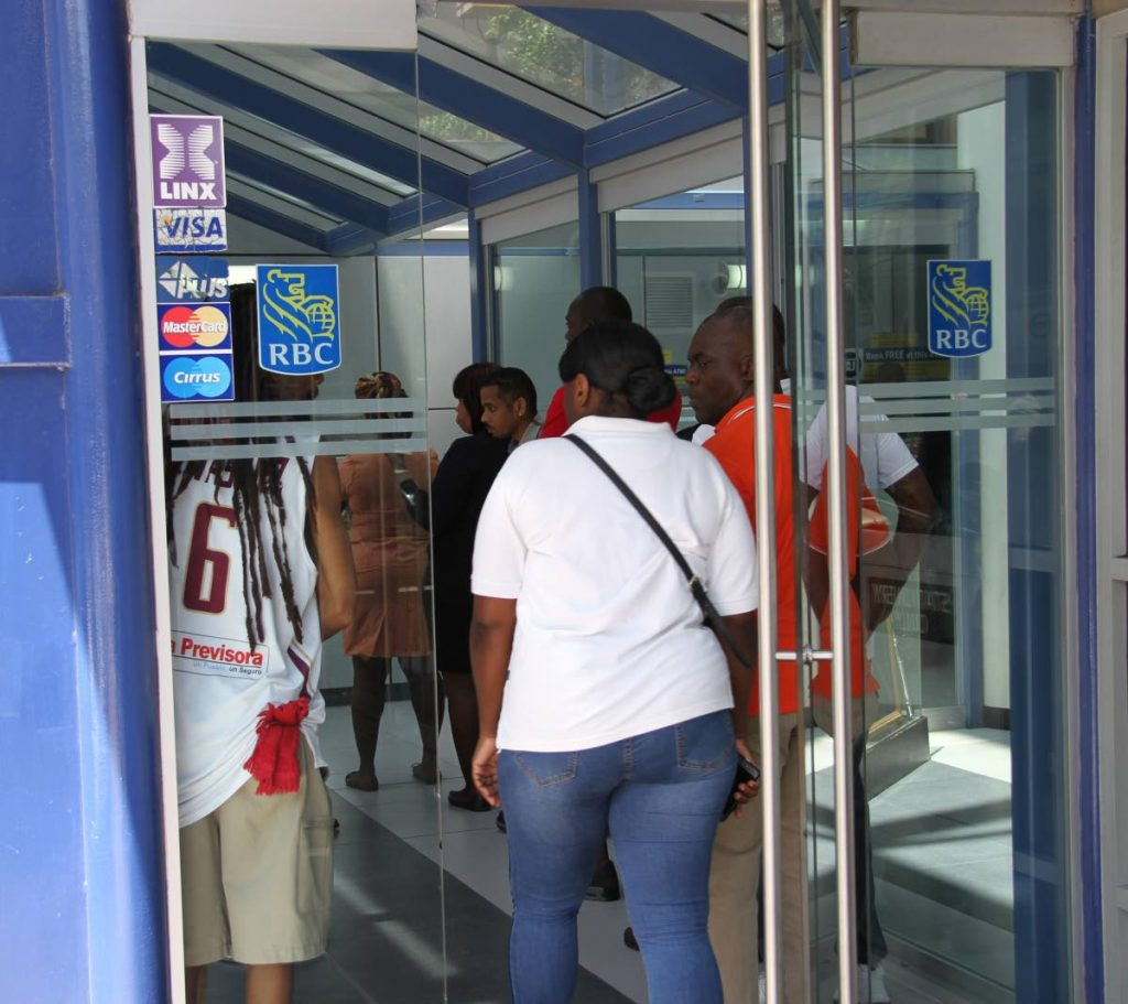 FILE PHOTO: This May 28, 2018 file photo shows a long line of people waiting to use the ATM at RBC Royal Bank's (RBC) Park Street, Port of Spain branch. PHOTO BY SUREASH CHOLAI