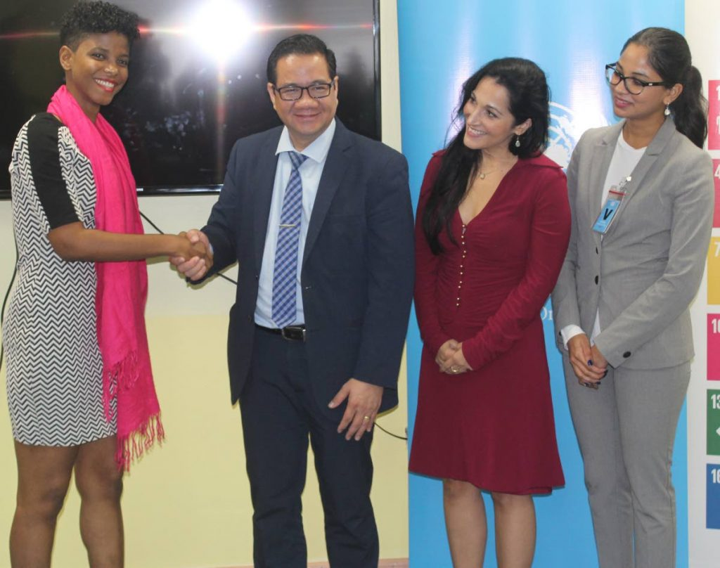 SUSTAINABLE MINDS: From left to right, Elysse Marcellin, Dr Edwin Bolastig, Stacey Camacho and Ashvni Nath at the official launch of Building Sustainable Minds. PHOTO BY ENRIQUE ASSOON