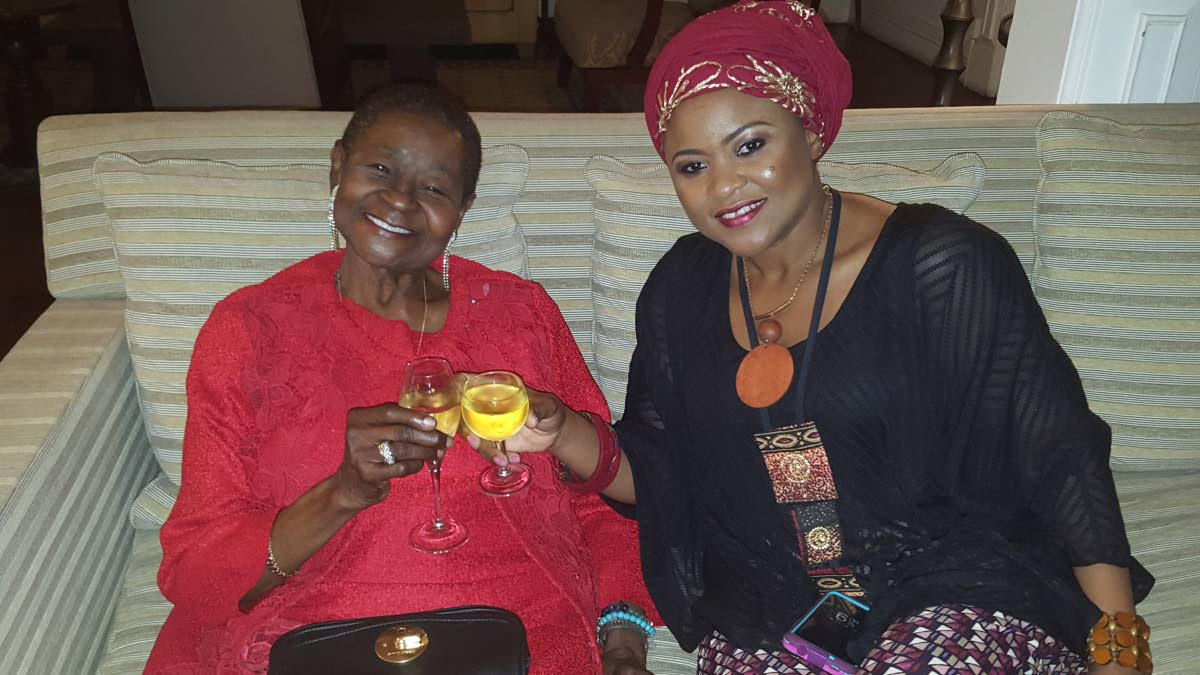 Calyps Rose shares a toast with Community Development, Culture and the Arts Dr. Nyan Gadshy-Dolly, at a reception at the French ambassador's house.