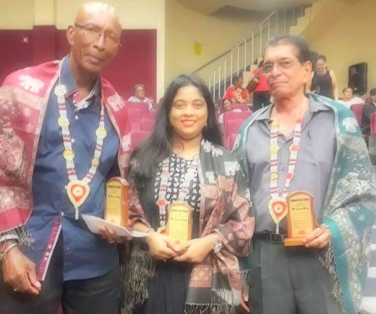 Norvan Fullerton,  left, Ananda Lawkaran and Ralph Maraj.