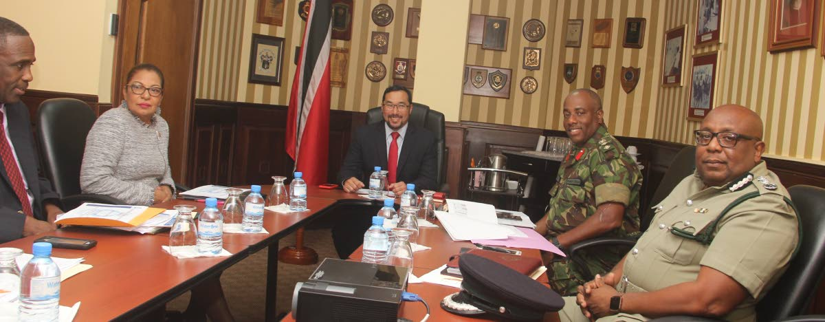 On the Job. New National Security Minister Stuart Young meets with top officials at the ministry's office at Temple Court on his first  day in office. PHOTO COURTESY  THE MINISTRY OFNATIONAL SECURITY