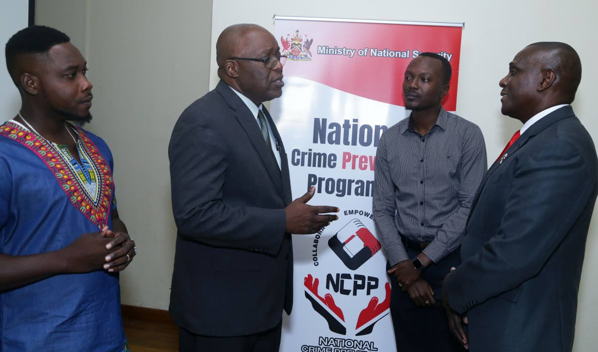 From left, Wade David, President of the Canaan/Bon Accord Village Council, stands with Chief Secretary Kelvin Charles, Assemblyman Ancil Dennis - THA's representative on the Inter-Ministerial Committee of the NCPP Council, and Retired Major General Rodney Smart, National Coordinator of the National Crime Prevention Programme at the first public consultation in Tobago last Tuesday evening at the Canaan/Bon Accord community centre.