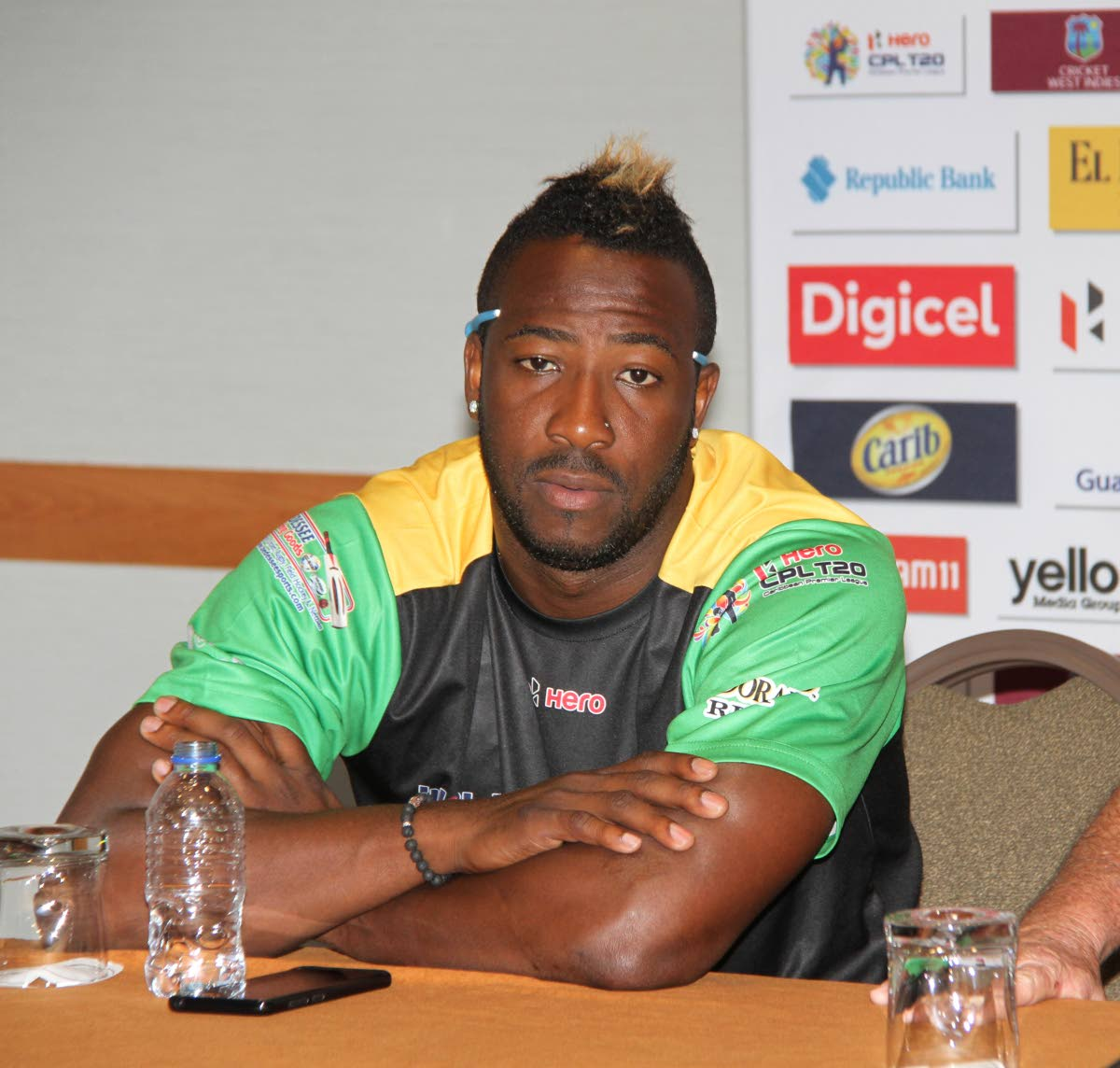 Jamaica Tallawahs captain Andre Russell addresses the media during a press conference yesterday ahead of today's Caribbean Premier League match against the Trinbago Knight Riders.