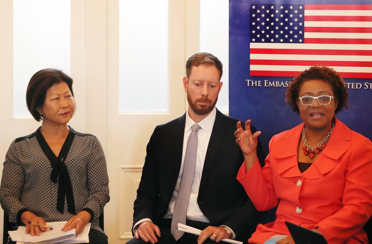 Panel discussion on migrant smuggling and human trafficking in the Caribbean held at the Writers Centre. At right Alana Wheeler of the Counter Trafficking Unit speaks as political officer at the US Embassy Kyle Fonay and Mary Moonan of Childline looks on.