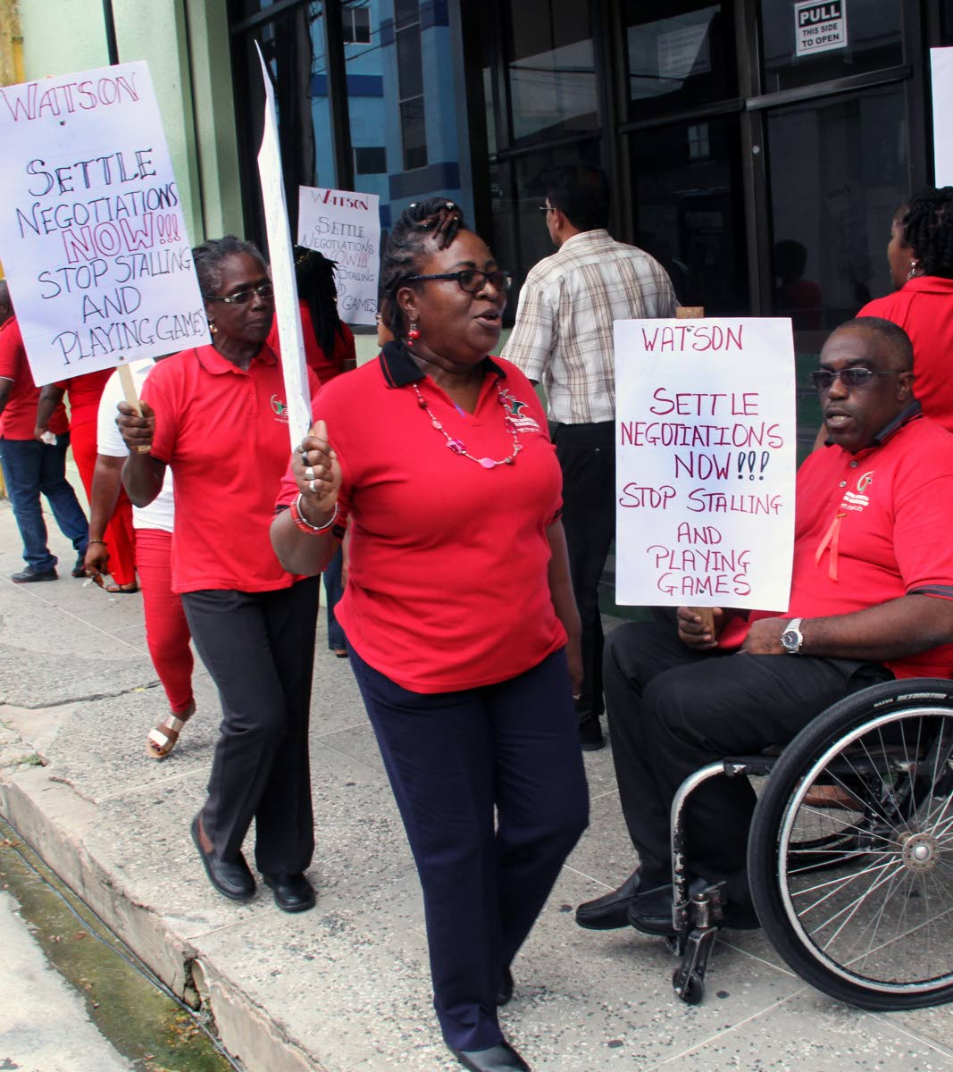 UNION VS UNION: PSA workers represented by Banking, Insurance and General Workers Union protest outside their association's head office on Abercromby Street, Port of Spain,  yesterday. PHOTO SUREASH CHOLAI