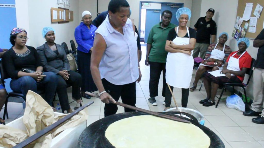 TT's Ambassador to the UN, Pennelope Beckles-Robinson concentrates on her roti making. Beckles-Robinson visited The Rose Foundation's Beyond Borders programme cuisine exchange at the Beetham Gardens Community Centre last August.