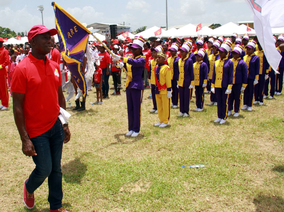 Prime Minister Dr Keith Rowley inspects the teams at the PNM Sports and Family Day at Edinburgh 500 Recreation Ground, Chaguanas on August 12. Rowley announced he will contest the party elections with a slate of candidates. PHOTO BY ANIL RAMPERSAD.