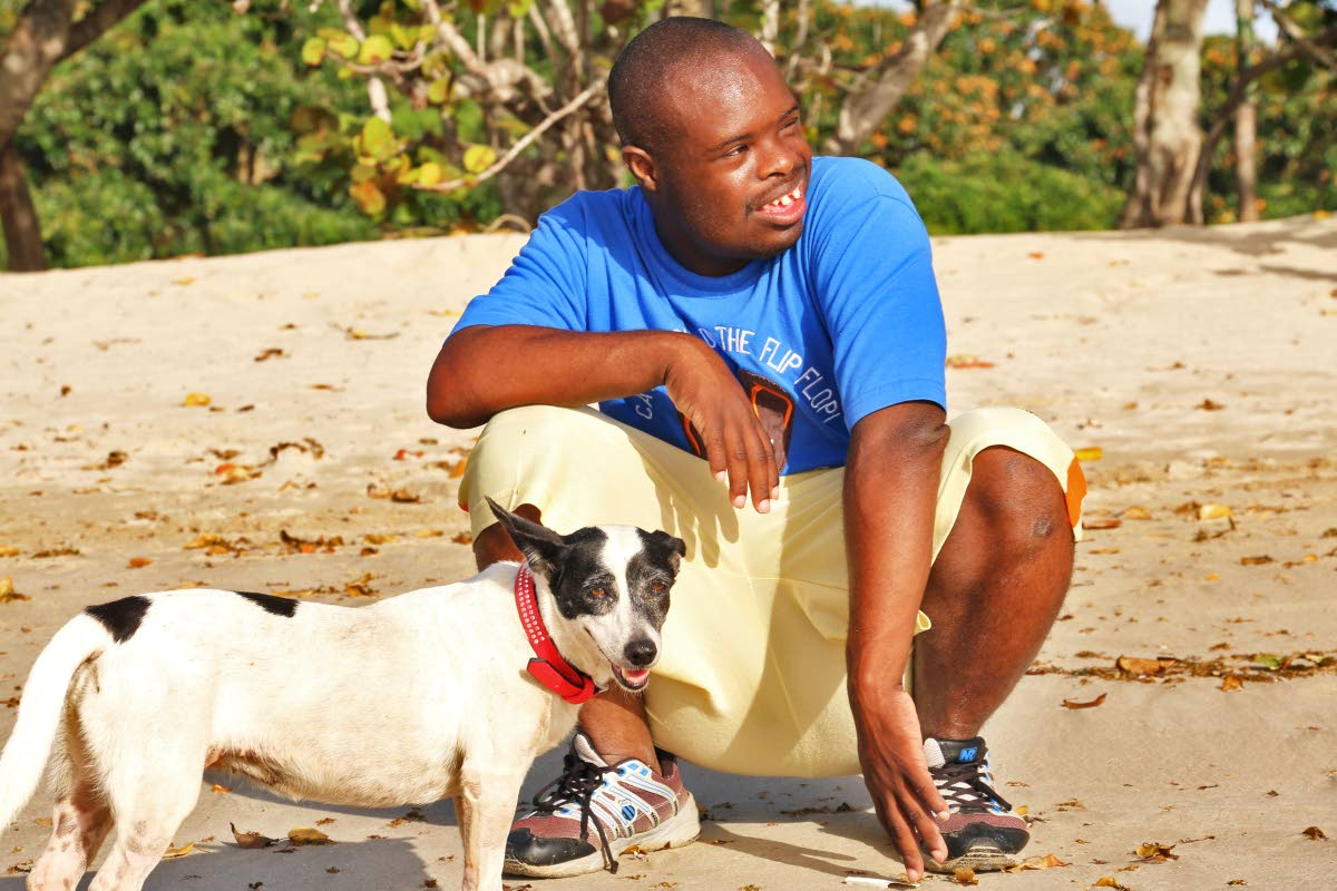 Keron McLetchie, HWH groom, spends quality time with Lopez, the dog. Photo: Welmoet Falke