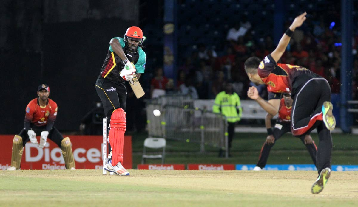Trinbago Knight Riders bowler Ali Khan sends down a delivery against St Kitts and Nevis Patriots' Chris Gayle at the Queen's Park Oval, St Clair, Saturday.