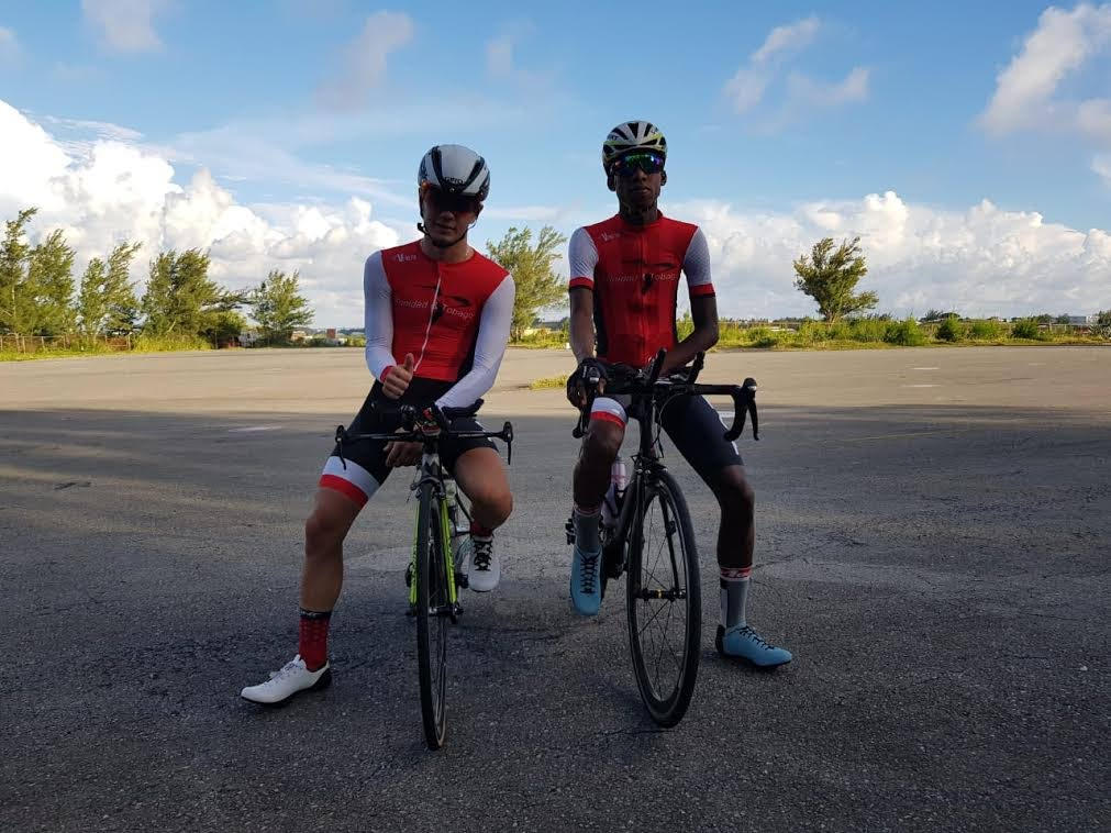 TT junior cyclist Enrique Comarmond, left, and juvenile Tarique Woods at the 2018 Junior Caribbean Cycling Championships held in Bermuda last weekend.