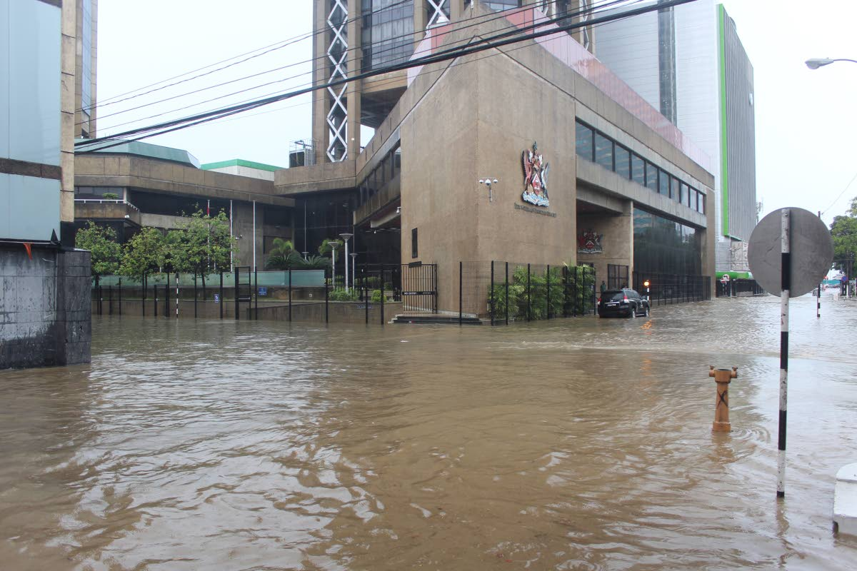 WATER PAIN: Water is everywhere after heavy rainfall yesterday in downtown Port of Spain.