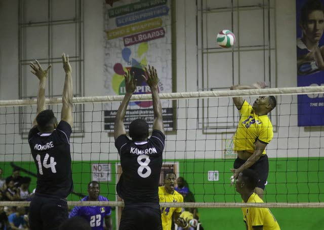 Barbados on the attack as TT's Marc Honore and Kameron Donald defend at the CAZOVA Championships in Suriname.