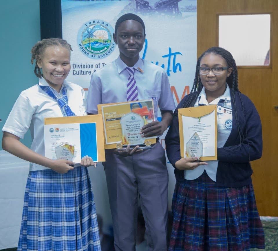 Junior Secretary of Tourism Jahmone Madden, centre, is flanked by with first runner-up Tenomrette Pitcher, right, and second runner-up, Ledel Jeffers, after winning the Junior Secretary Competition on July 3 Tourism Youth Forum hosted by the Division of Tourism at the Shaw Park Cultural Complex. THA Photo