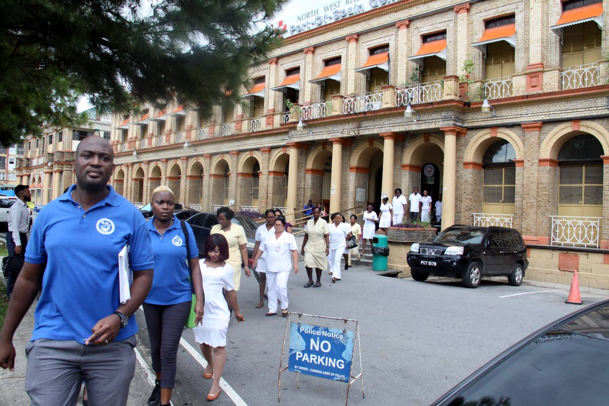NURSES STRIDE OUT: Registered nurses, led by TTRN President Idi Stuart, walk out of the PoSGH, protesting lack of security at the facility.