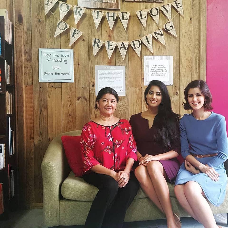 Nadjimie Khan, left, Miss World TT Ysabel Bisnath and Aara Cleghorn share a light moment at the Book Corner in Mode Alive,  Valsayn.